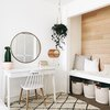 Minimal office space with white desk and ladderback chair and circular mirror