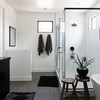Black and white shower and bathroom