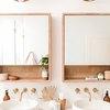 nude boho bathroom wall lighting idea with double sink