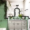 Green midcentury shower tile ideas in bathroom with plants and white walls