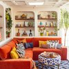 small family room ideas with shelving and orange sofa