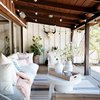 Covered outdoor patio area with bohemian decor