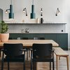 Pendant and wall sconce kitchen lighting with green cabinets and open shelving