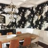 dining room with floral wallpaper and rustic dining table