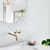 white bathroom countertop idea with marble and fishscale wall tile with wall-mounted faucet