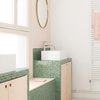 tile bathroom countertop ideas with green mosaic countertops and light wood cabinets