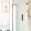 Corner shower with glass door and marbled walls