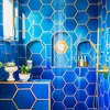 hexagon shaped blue shower tile in bohemian bathroom