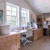 Plywood built in desk and drawer set up with shelves in arched ceiling room with Home Office Desk Ideas