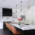 These 12 White Kitchens With Dark Islands Prove Contrast Is Key