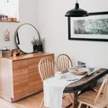 Mixed Wooden Finishes Create a Cozy Dining Room Design
