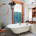 All-Over Penny Tile Adds Intrigue to a Charming Bathroom