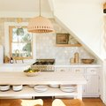 Have a One-Wall Kitchen? Here Are 8 Ways to Incorporate an Island