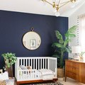 A Stunning Accent Wall Creates a Dynamic Nursery Design