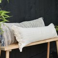 Weekend Project: Turn an IKEA Rug Into Cute Fringed Bench Pillows
