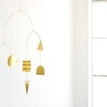 This DIY Modern Brass Mobile Works in Any Room (Not Just Nurseries!)