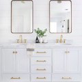 Brass, White, and Polka Dots Is a Stunning Bathroom Combination