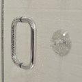 How to Repair a Hinged Shower Door