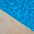 How to Stain Concrete Around a Swimming Pool