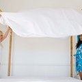 How to Fit a Queen Fitted Sheet to a Full Size Bed