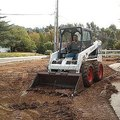How to Grade Soil Using a Bobcat or Back Hoe