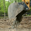 How to Dig a Pond With a Backhoe