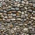 How to Build a Stone Wall With Round Stones & Cement