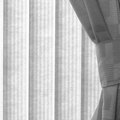 How to Hang Curtains With Vertical Blinds