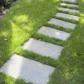 How to Set Flagstone in Grass