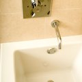 How to Remove a Pop Up Bathtub Plug and Unclog the Drain