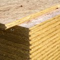 What Is the Difference Between Particleboard & Fiberboard?