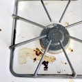 How to Remove Burnt-On Grease From a Stove Top