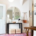 Even a Small Entryway Shines When a Round Mirror's Involved