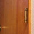 How to Adjust a Spring-Loaded Door Hinge