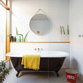 This Accessory Makes Claw-Foot Tubs Look as Good as They Make Us Feel