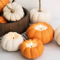 Excuse Us While We DIY the Cutest Pumpkin Candles
