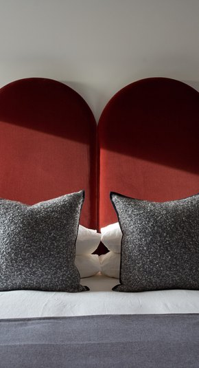 bedroom with red velvet headboard