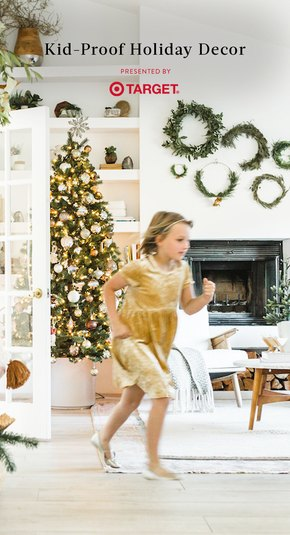 Child running in front of Christmas Tree