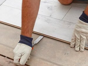Removing laminate flooring.