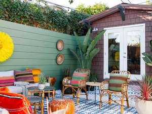 Colorful small patio ideas with green, yellow, orange, and red decor accents