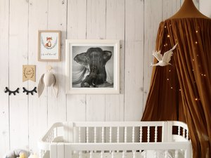 Nursery idea for 2020 with ceiling canopy around white crib