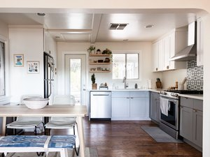 simple kitchen with small dining area and l-shaped layout