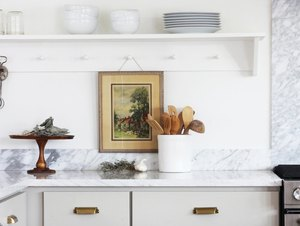 vintage farmhouse decorating idea with vintage oil painting and neutral colors