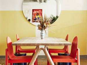 Photograph of yellow space with red chairs