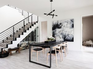 Modern black and white stairs with carpet runner and black railing
