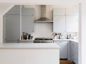 small kitchen, vent hood, island, powder blue cabinets, subway tile