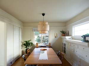 Modern dining room lighting idea with woven pendant