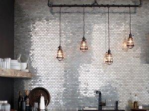stainless steel mini subway tile backsplash in modern kitchen