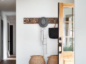 boho farmhouse entryway with concrete and wood floor