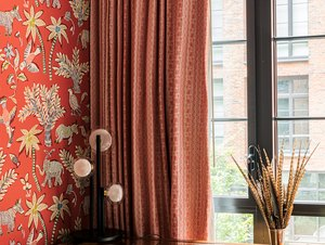 red home office wallpaper with matching window treatments, a desk pushed against the window